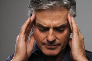 Почему болит голова в области висков
