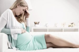 У беременной боли в желудке